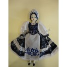 93. Porcelain doll in traditional blue dyed costume, 35 cm