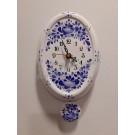 715. Kézzel festett,  kerámia, ingás falióra, kék virágos - kis ovál